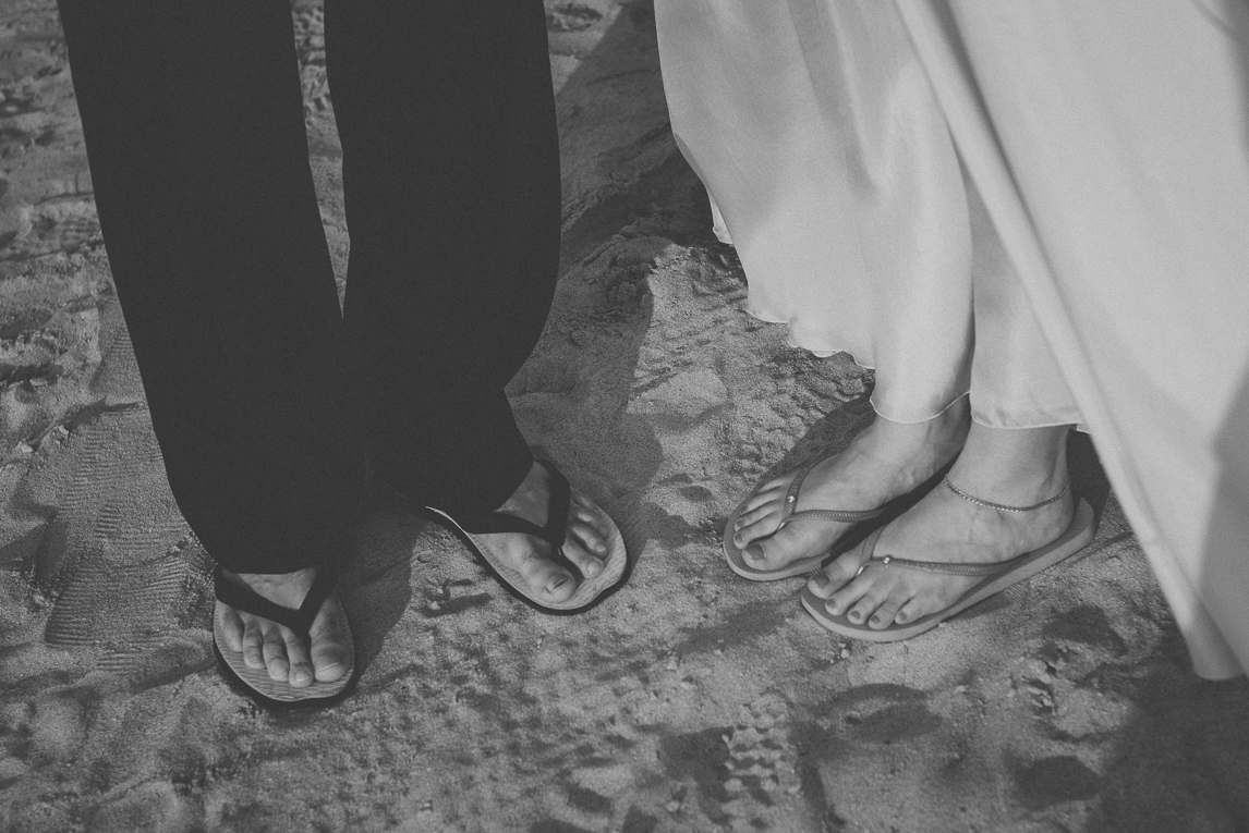 rozimages - wedding photography - bride and groom in flip fops on sand, close-up on feet - Broome, Australia