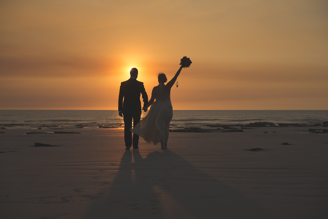 rozimages - wedding photography - bride and groom on the beach, walking towards the sea and sunset - Broome, Australia