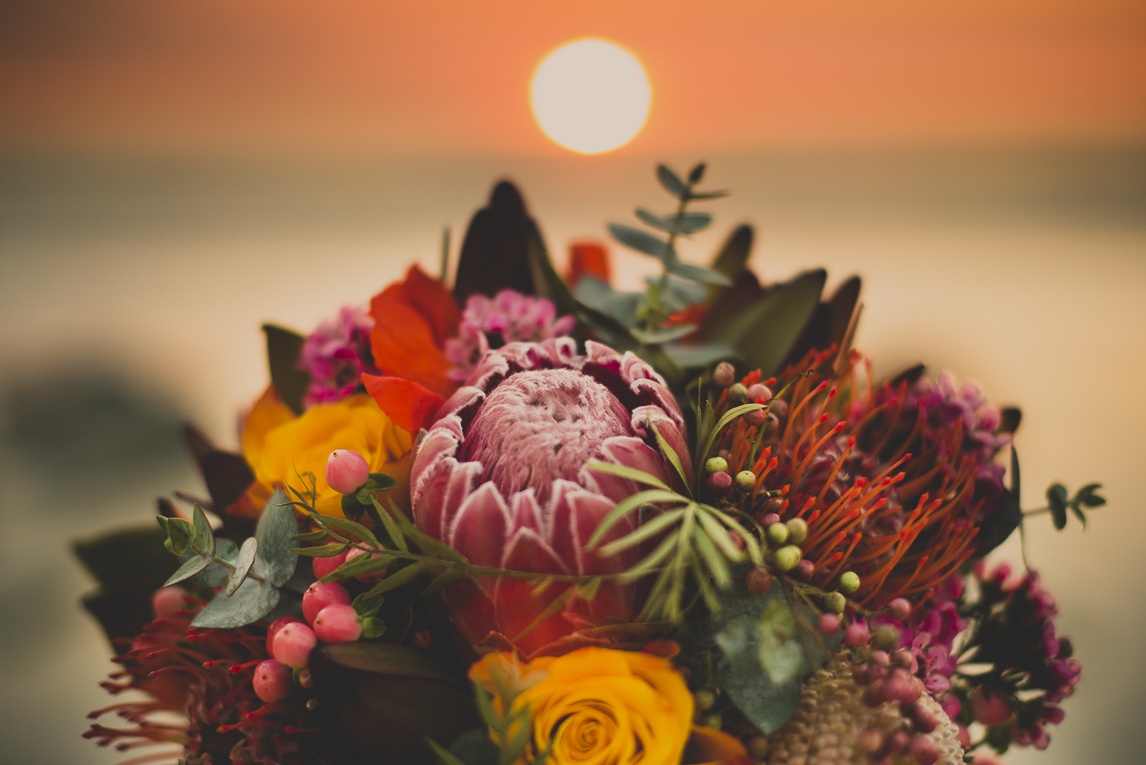 rozimages - wedding photography - close-up of bouquet with sunset in background - Broome, Australia