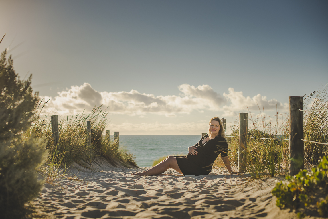 rozimages - pregnancy photography - maternity photography - pregnant woman sitting on the sand - City Beach, Perth, Australia