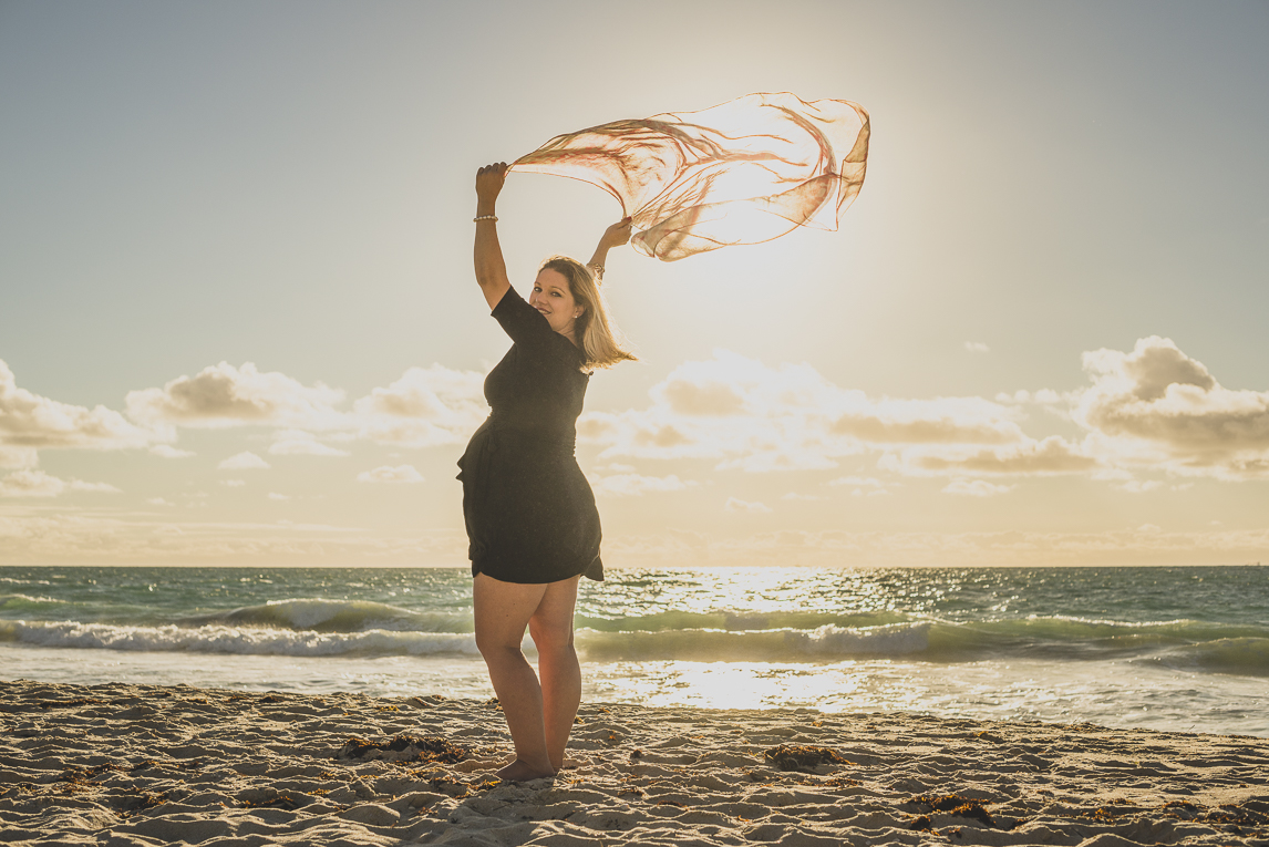 rozimages - pregnancy photography - maternity photography - pregnant woman holding sarong in the wind - City Beach, Perth, Australia