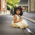rozimages - portrait photography - family session - Little girl sitting in the street - Oxford, England