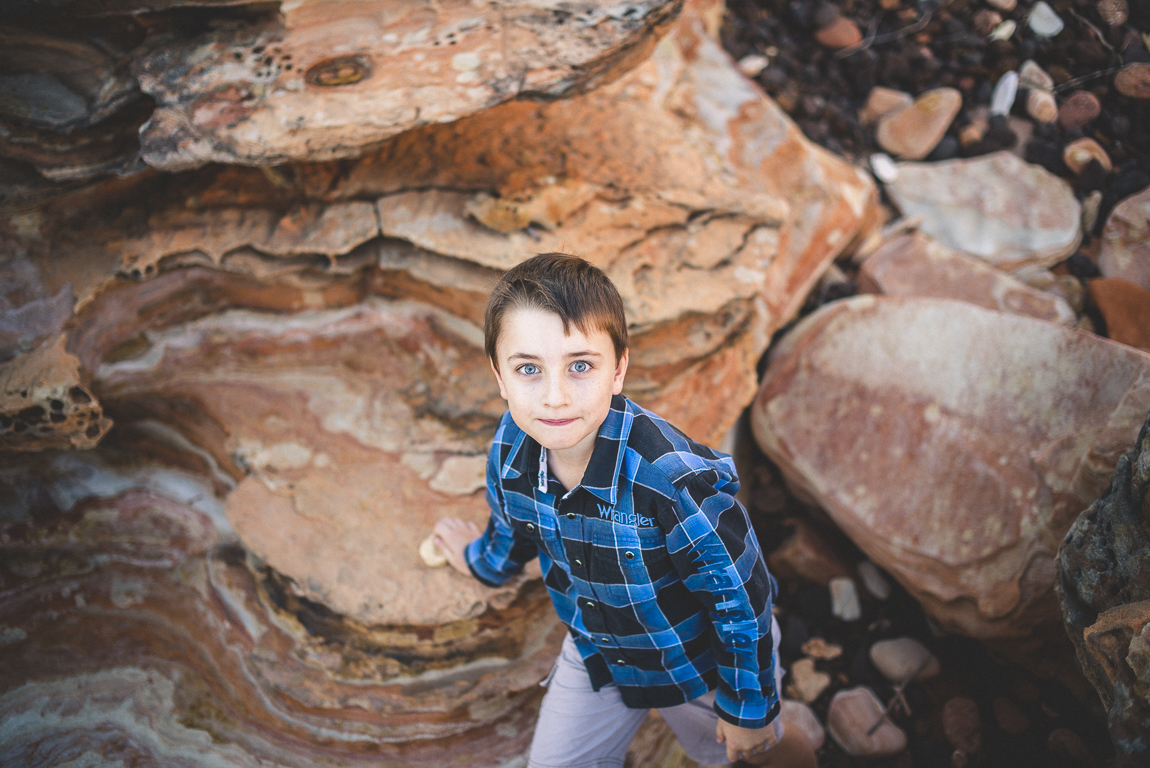 rozimages - family photography - beach session - boy walking through rocks - Reddell Beach, Broome, Australia