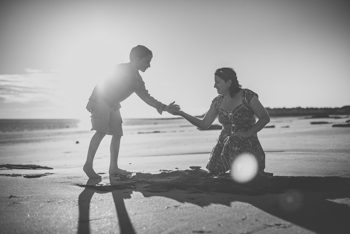 rozimages - family photography - beach session - mother and her son finding and sharing shells on beach - Reddell Beach, Broome, Australia