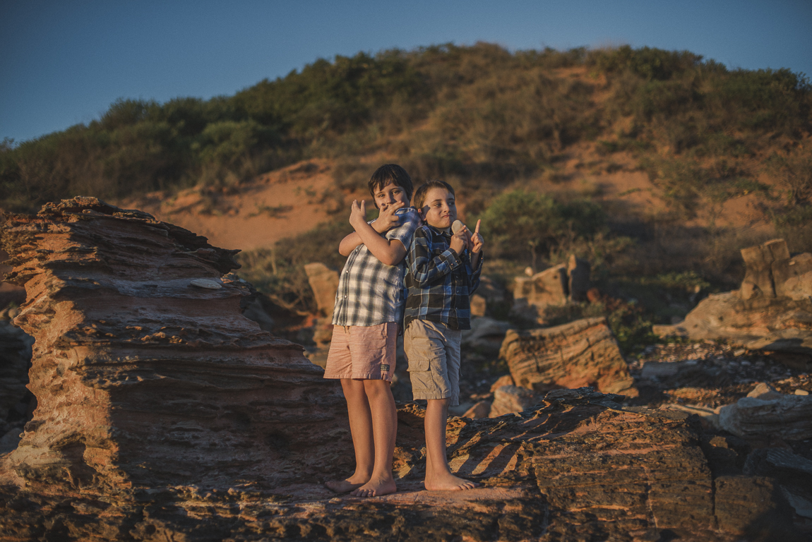 rozimages - family photography - beach session - portrait of two boys standing on rocks - Reddell Beach, Broome, Australia