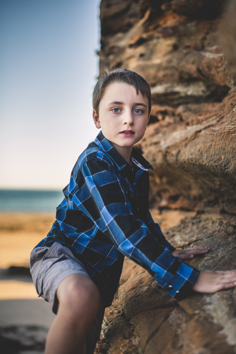 rozimages - family photography - beach session - boy climbing rock on beach - Reddell Beach, Broome, Australia