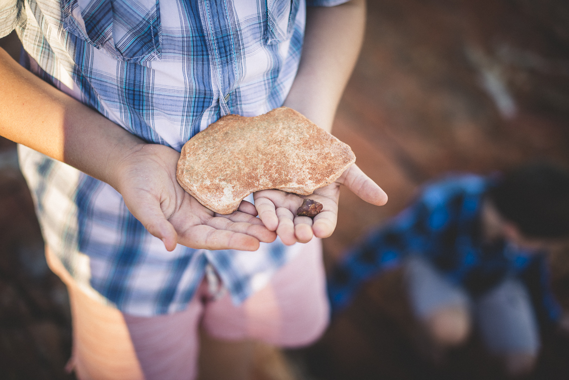 rozimages - family photography - beach session - boy holding a rock in the shape of Australia - Reddell Beach, Broome, Australia