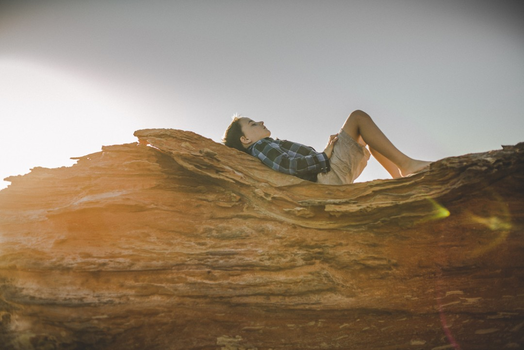 rozimages - family photography - beach session - boy lying on rock - Reddell Beach, Broome, Australia