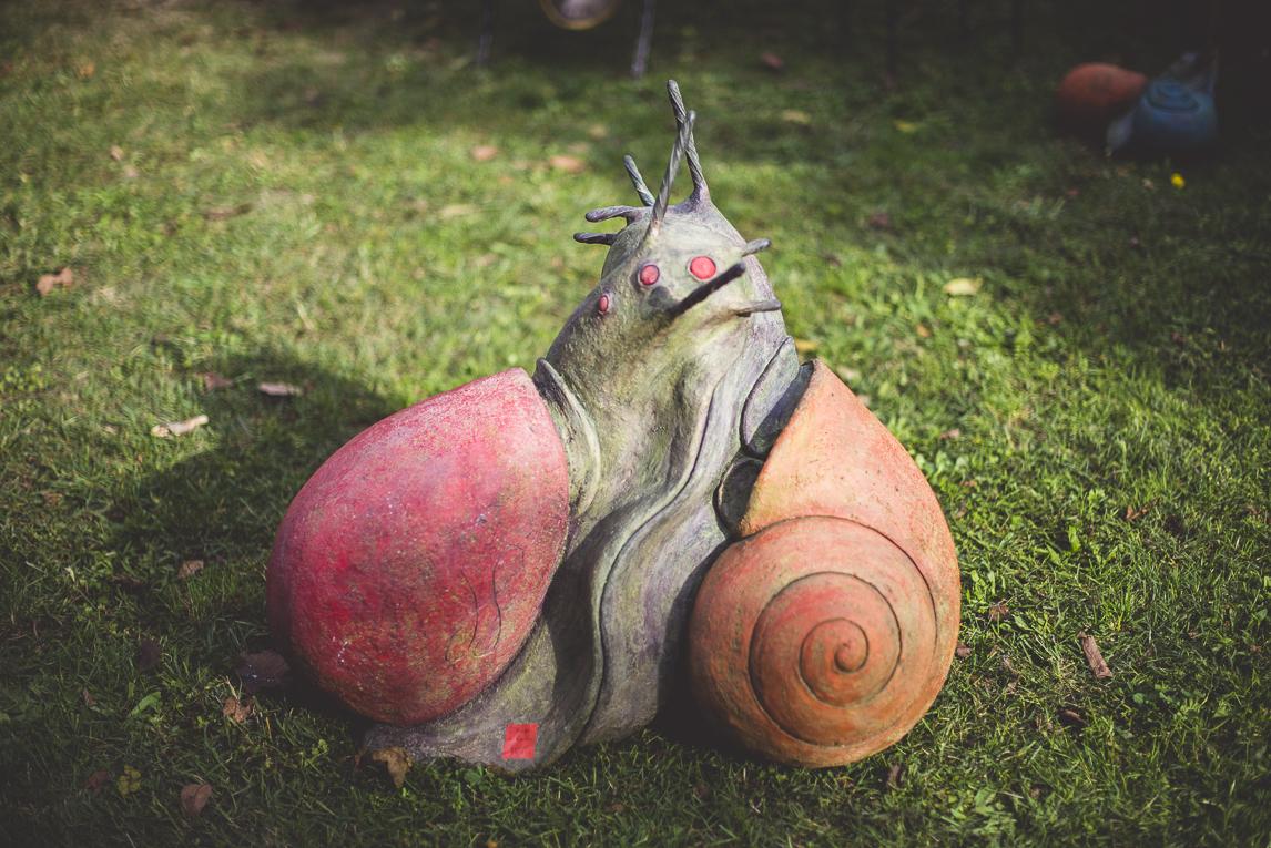 rozimages - photographie évènementielle - Expo Vente de Végétaux Rares 2015 - sculpture de deux escargots - St Elix le Chateau, France