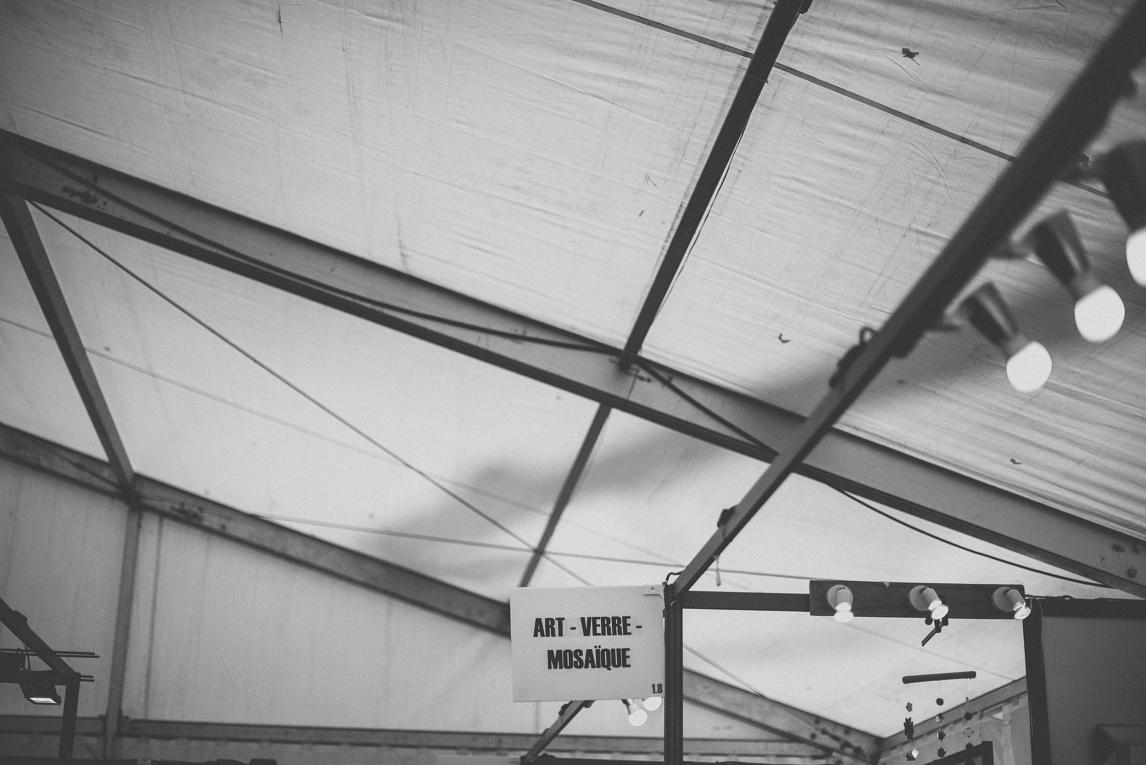 rozimages - photographie évènementielle - Salon des Arts et du Feu 2015 - panneau au-dessus d'un stand - Martres-Tolosane, France