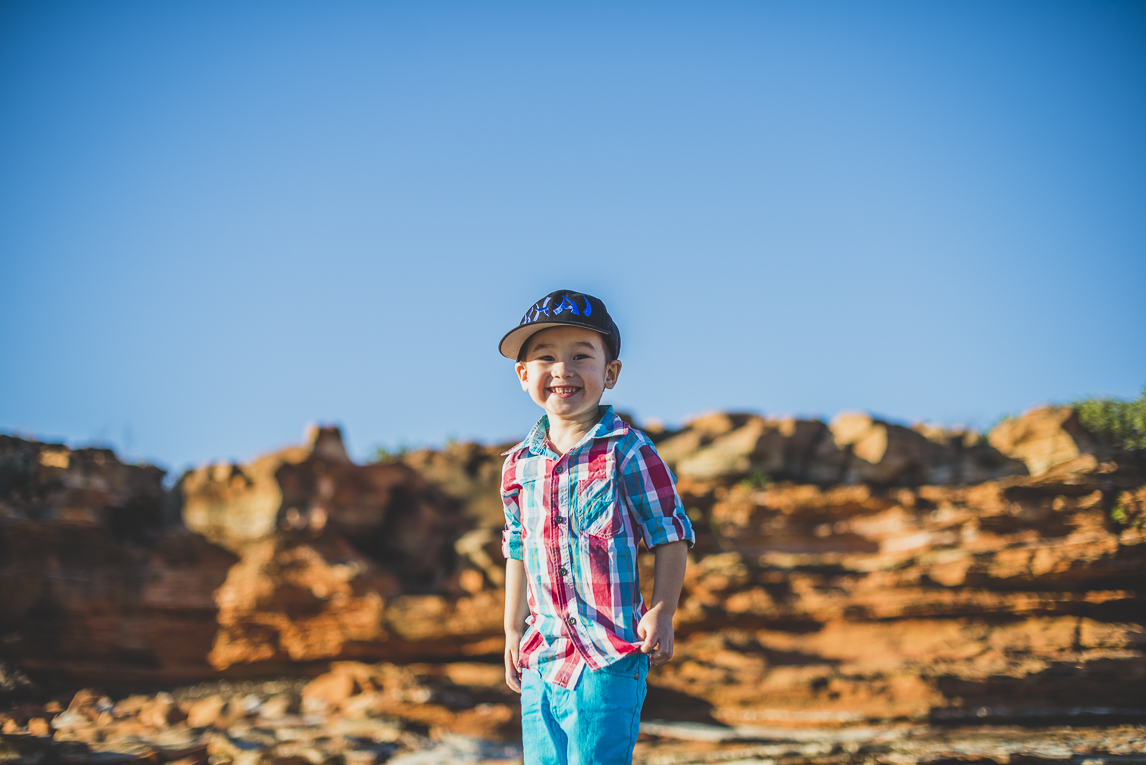 rozimages - family photography - beach session - boy standing on rock - Reddell Beach, Broome, Australia