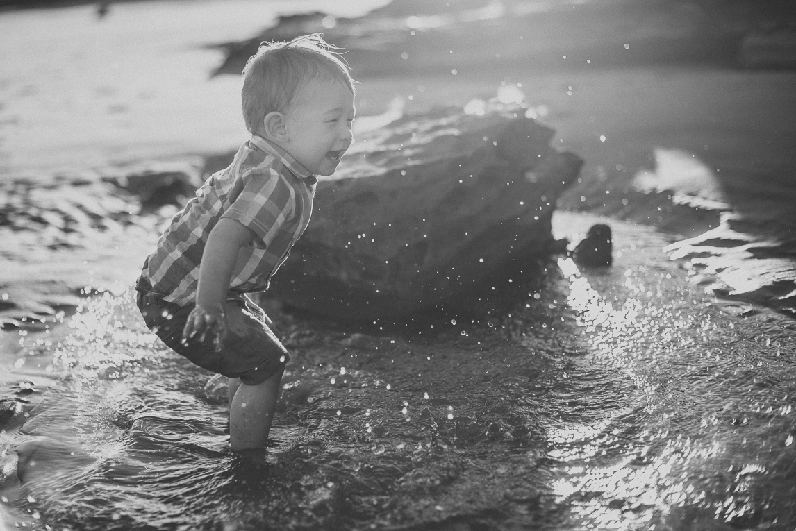 rozimages - family photography - beach session - little boy playing and splashing in water near rock - Reddell Beach, Broome, Australia