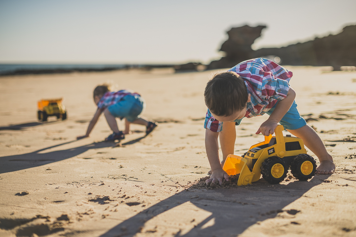 rozimages - family photography - beach session - two boys playing with toy trucks on beach - Reddell Beach, Broome, Australia