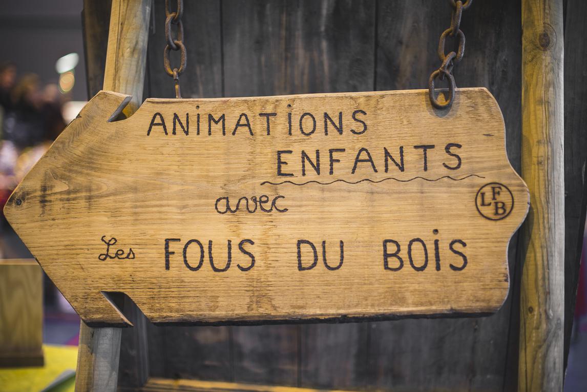 rozimages - photographie d'évènement - évènement communautaire - Marché de Noël 2015 - panneau en bois - Mondavezan, France