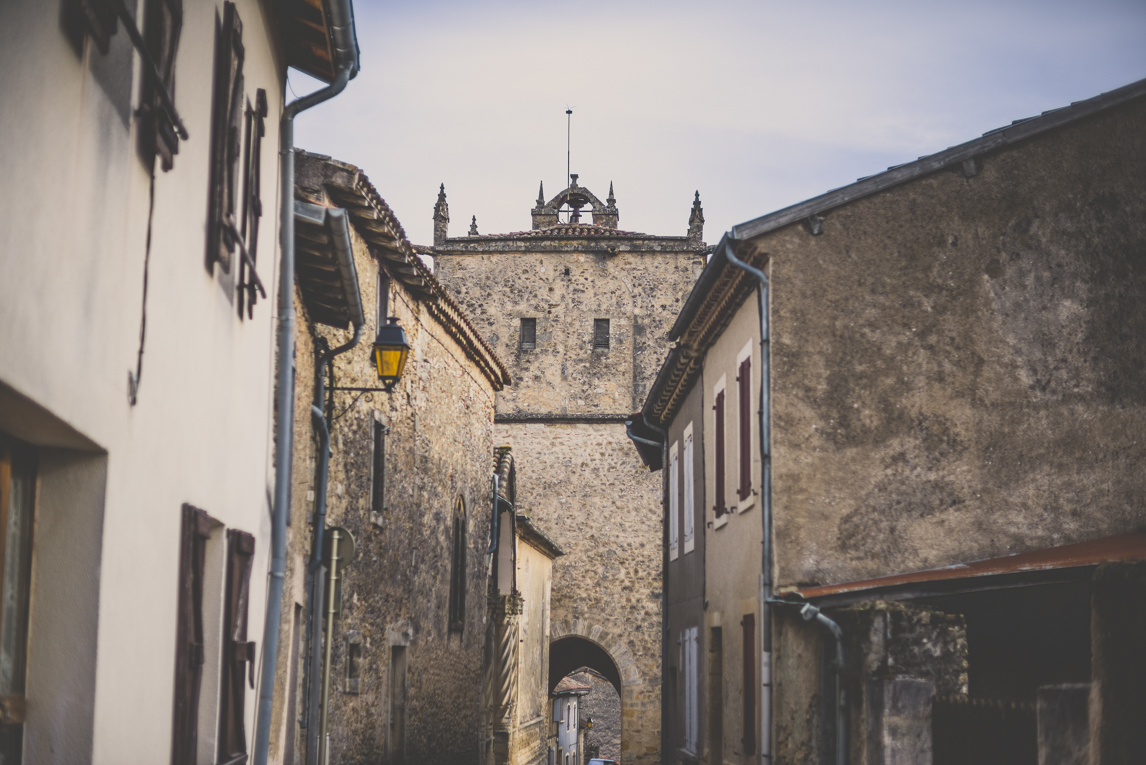 Photo of the French town of Aurignac - Eglise Saint-Pierre and street - Aurignac Photographer