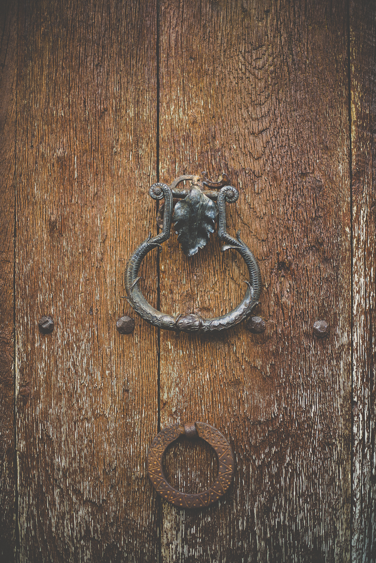 Photo of the French town of Aurignac - old knocker on wooden door - Aurignac Photographer