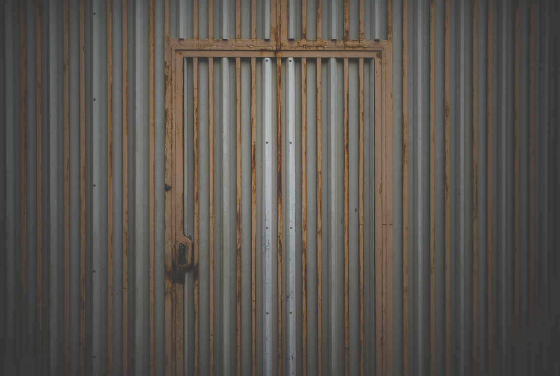 Photo of the French town of Aurignac - corrugated iron wall and door - Aurignac Photographer