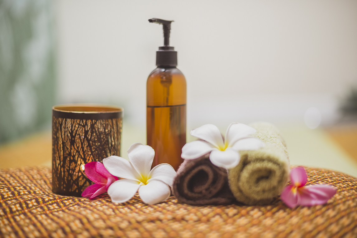 Thai Touch Massage Utopia Broome - rolled towels, oil bottle, candle and flowers - Commercial Photographer