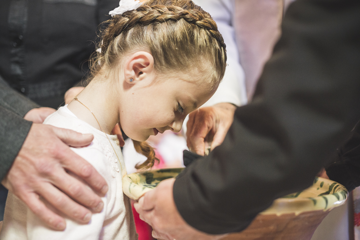 Baptism in Mondavezan - Pouring water on girl's head - Family Photographer