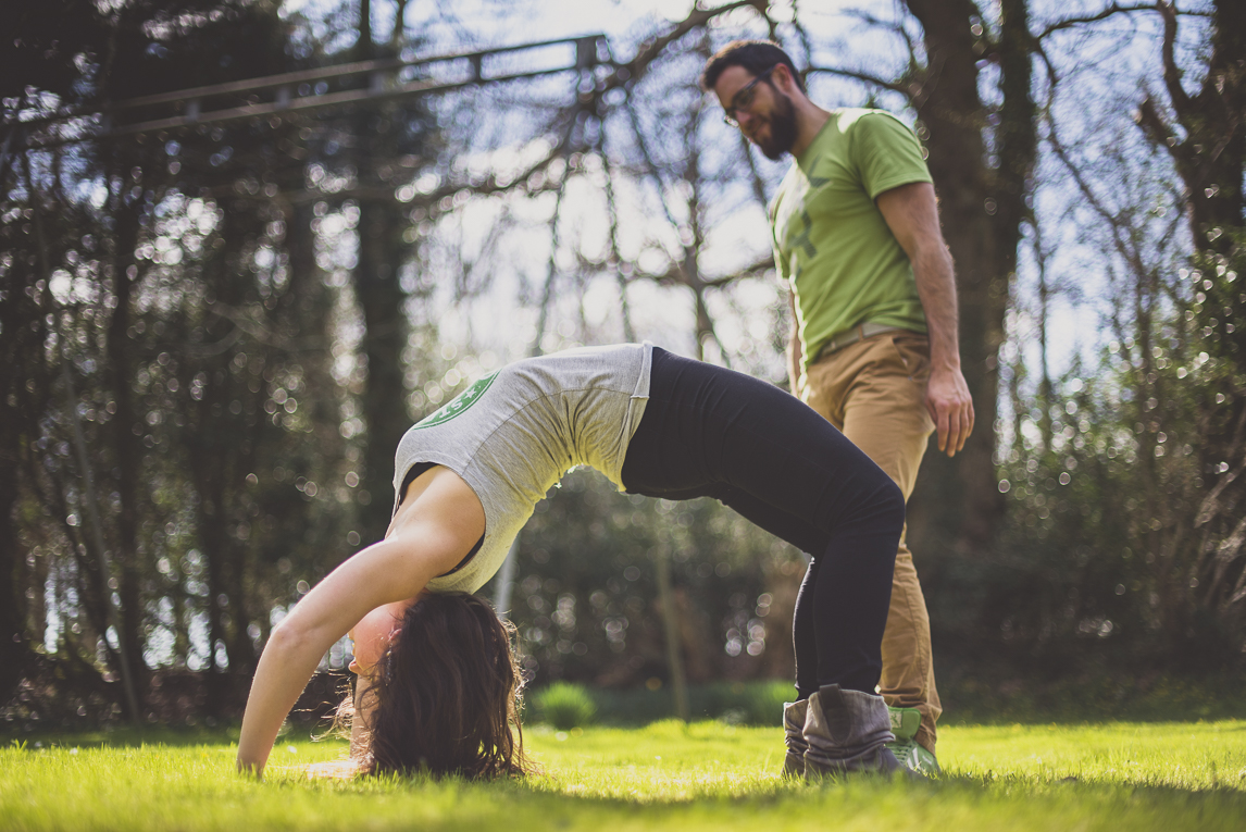 Couple session in Brittany - woman doing a bridge pose - Couple Photographer