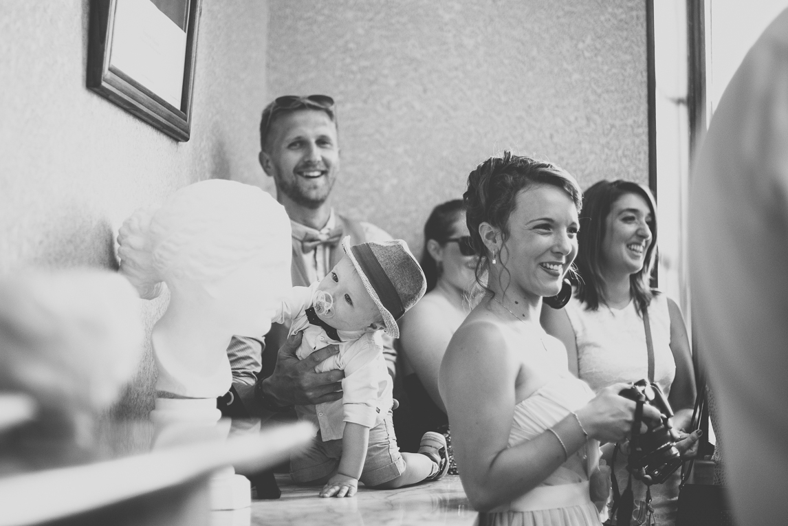 Wedding Photography South West France - guests and little boy at town hall - Wedding Photographer