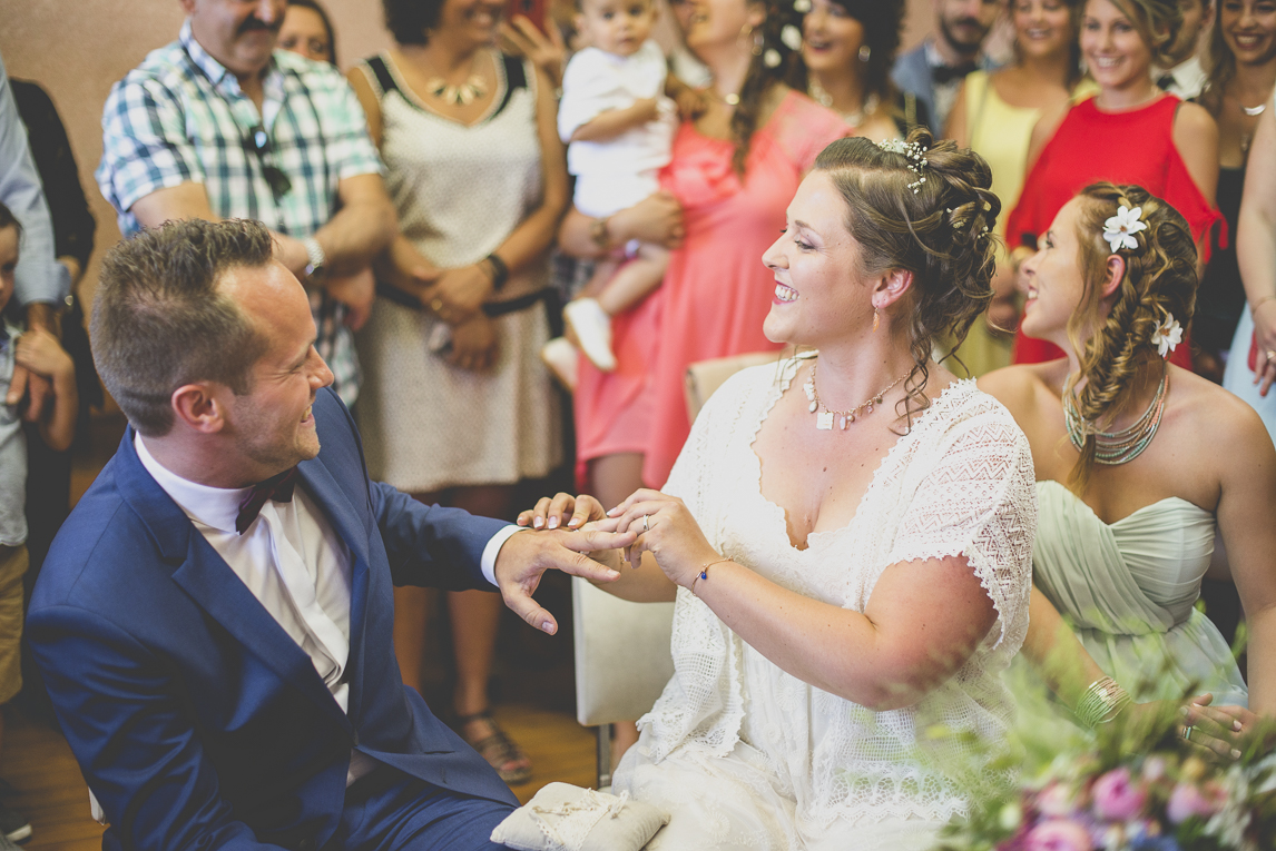 Wedding Photography South West France - bride and groom exchanging rings at town hall - Wedding Photographer