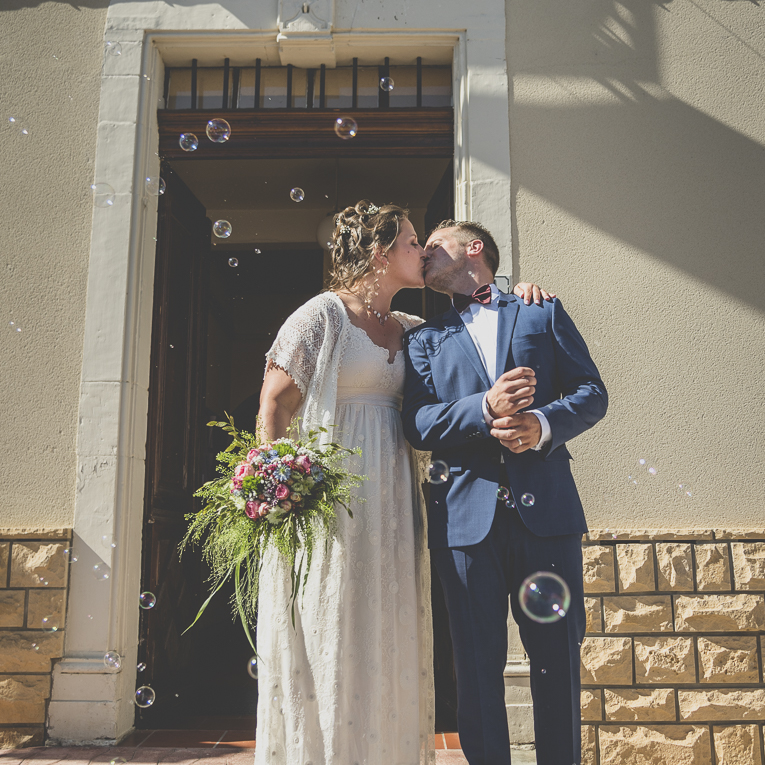Wedding Photography South West France - married couple kissing out of town hall - Wedding Photographer