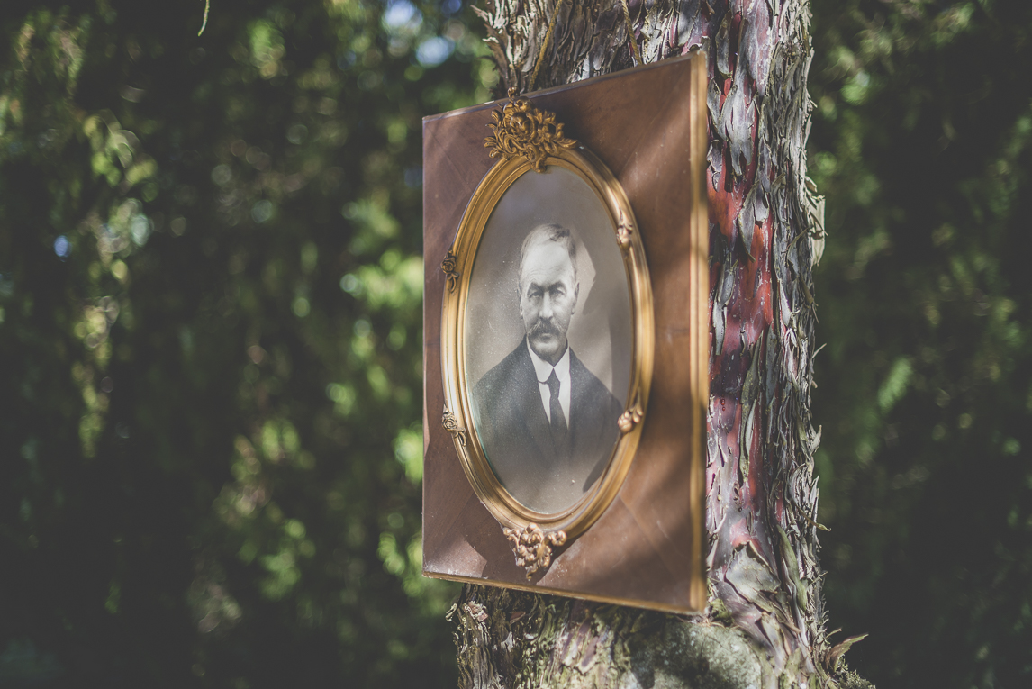 Wedding Photography South West France - old photo framed and put up a tree trunk - Wedding Photographer