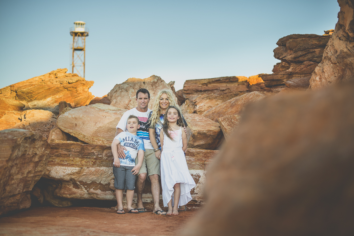 Family photo session - family posing among red rocks - Family Photographer
