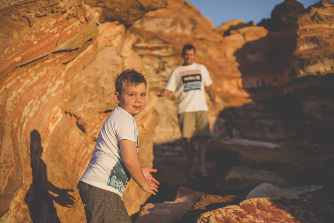 Family photo session - child and dad among red rocks - Family Photographer