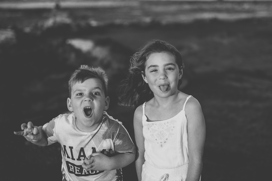 Family photo session - two children making funny faces - Family Photographer