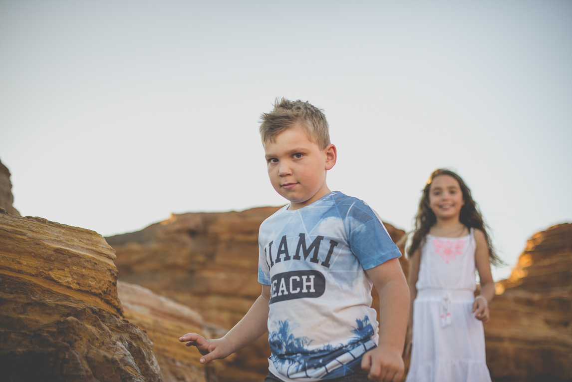 Family photo session - two children walk among rocks - Family Photographer