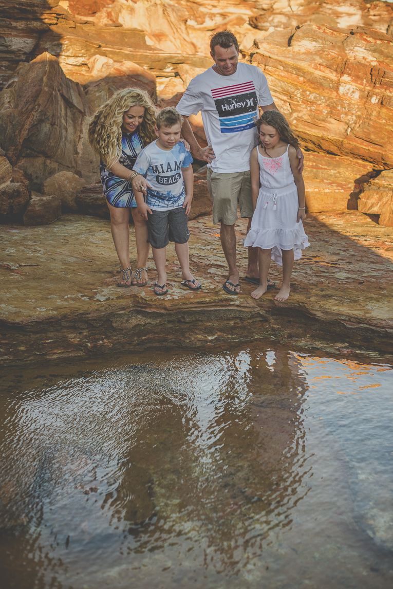 Family photo session - family look into a pond among rocks - Family Photographer
