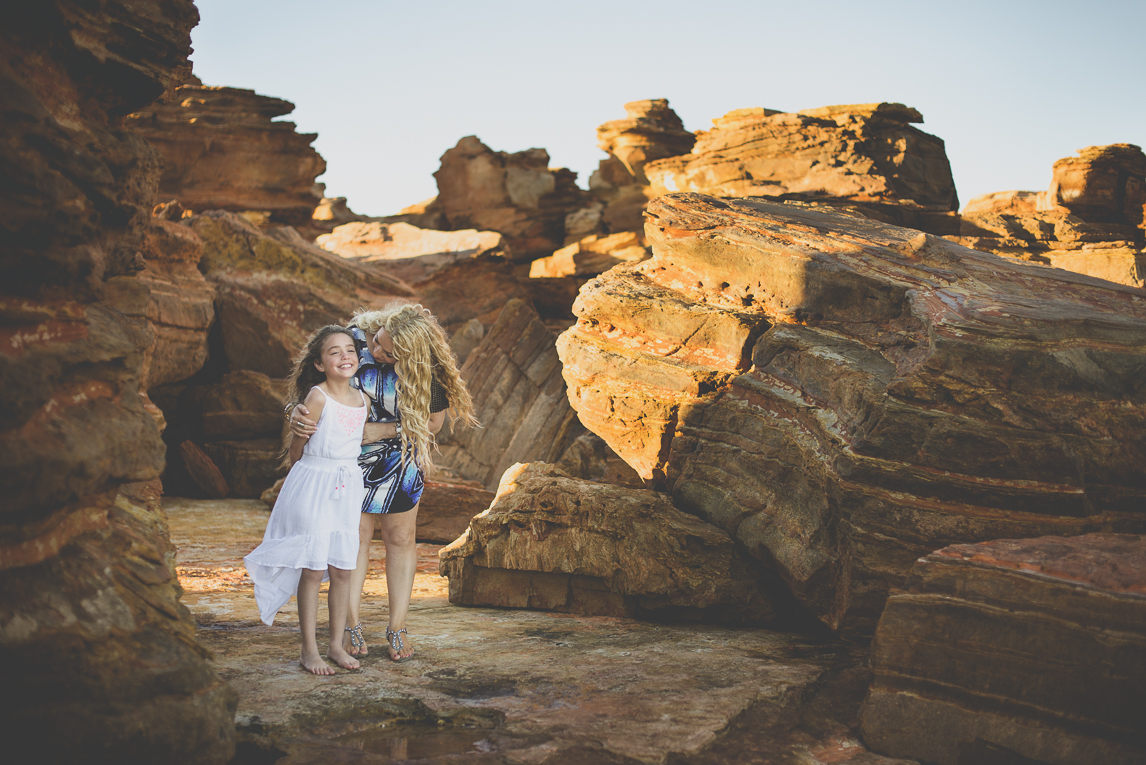 Family photo session - child and mum among red rocks - Family Photographer