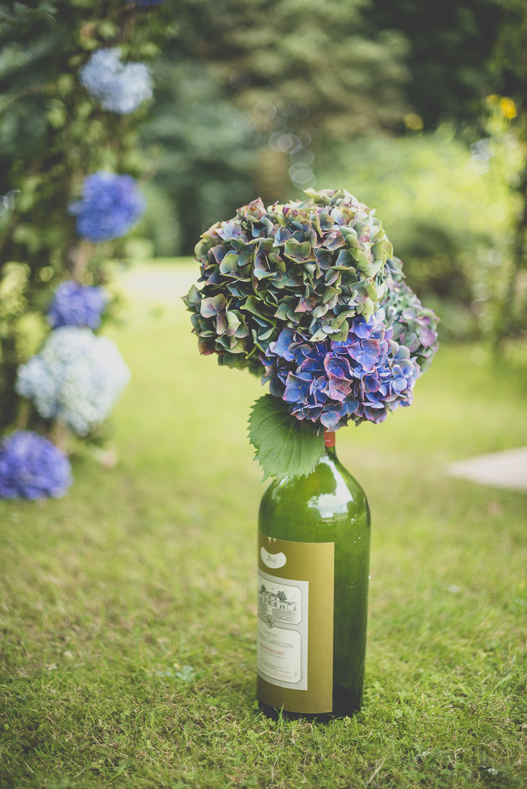 Wedding Photography Brittany - hydrangea flowers in glass bottles for wedding decoration - Wedding Photographer