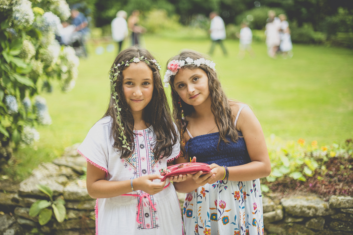 Wedding Photography Brittany - two little girls holding cushion with wedding rings - Wedding Photographer