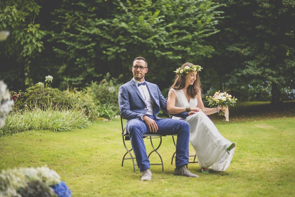 Wedding Photography Brittany - bride and groom sitting during outdoor ceremony - Wedding Photographer
