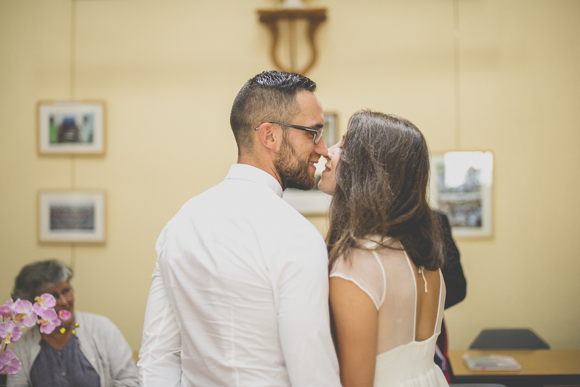 Wedding Photography Brittany - bride and groom kissing in town hall - Wedding Photographer
