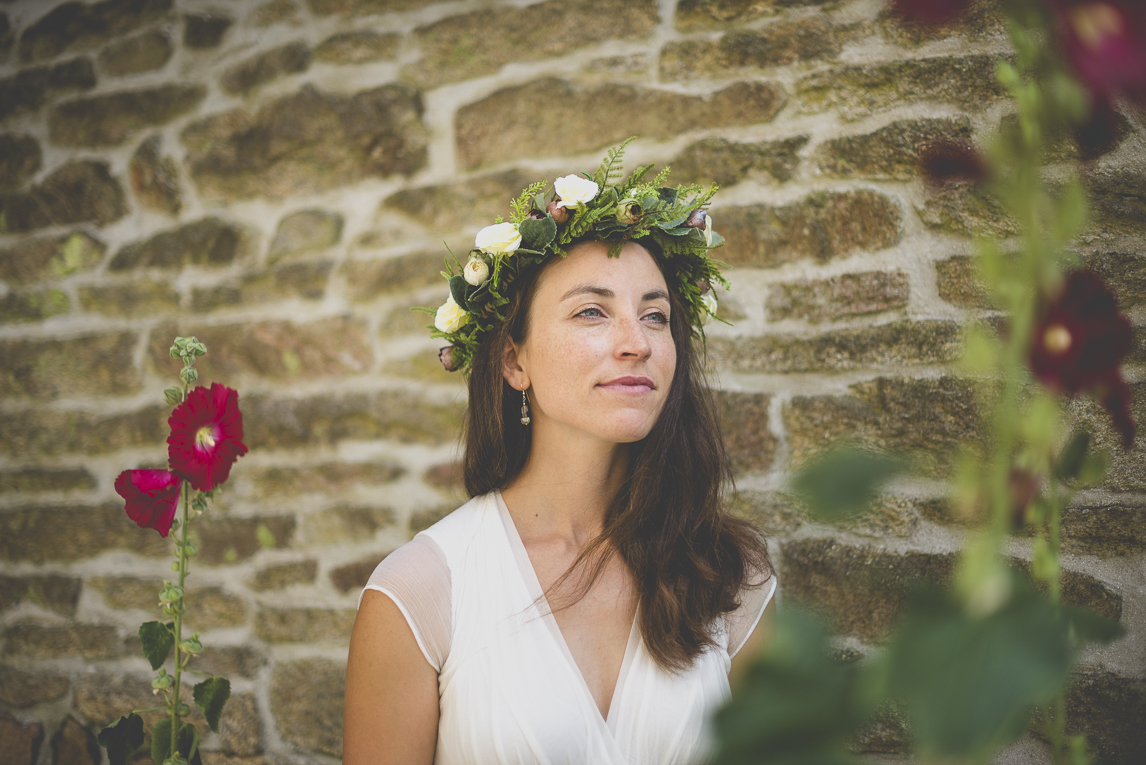 Wedding Photography Brittany - portrait of bride among hollyhock flowers - Wedding Photographer