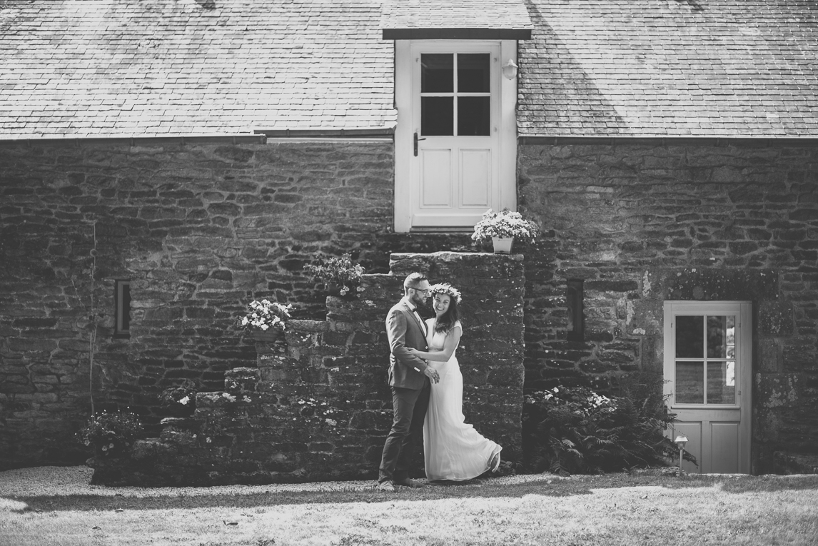 Wedding Photography Brittany - bride and groom in front of stone building - Wedding Photographer