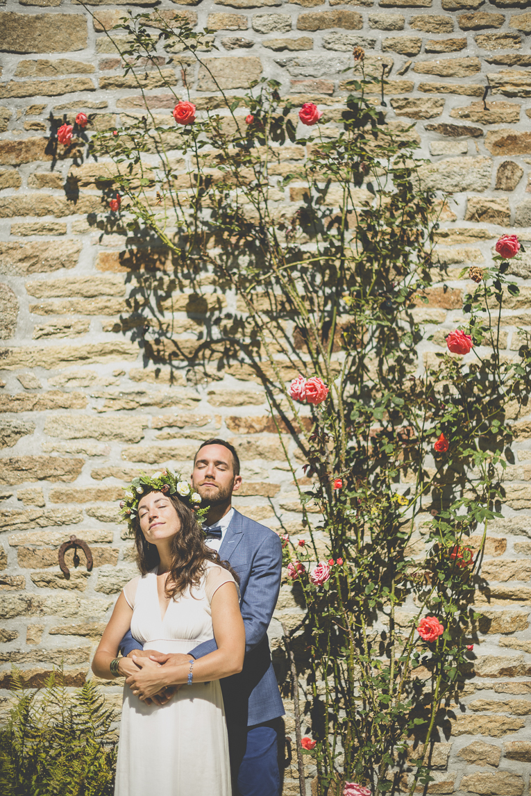Wedding Photography Brittany - bride and groom under rose tree - Wedding Photographer