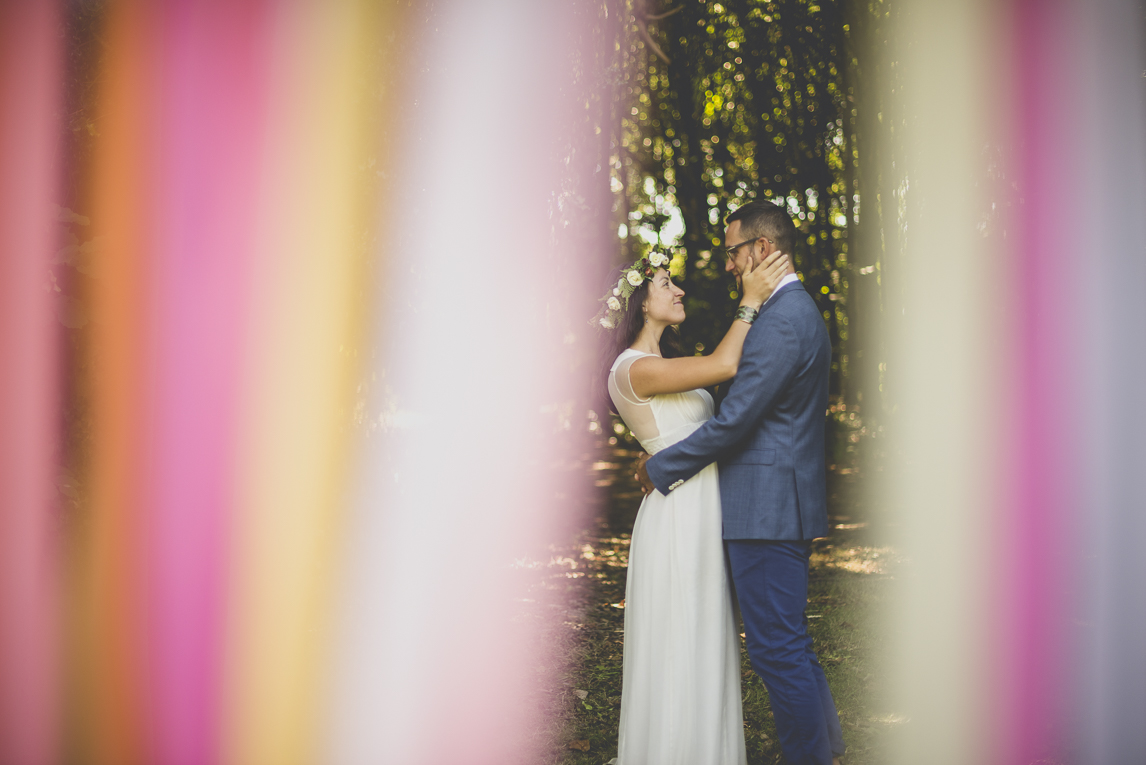 Wedding Photography Brittany - bride and groom hugging behind coloured ribbons - Wedding Photographer