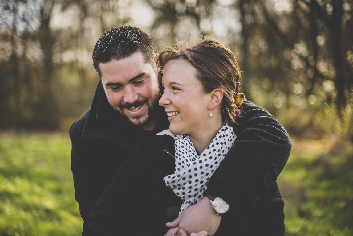 Couple session in the countryside - man and woman laugh - Couple Photographer