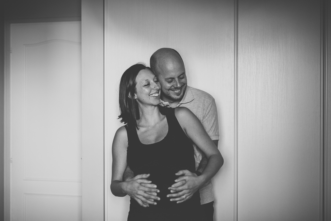 Pregnancy photo-shoot - man and pregnant woman hugging and smiling - Pregnancy Photographer