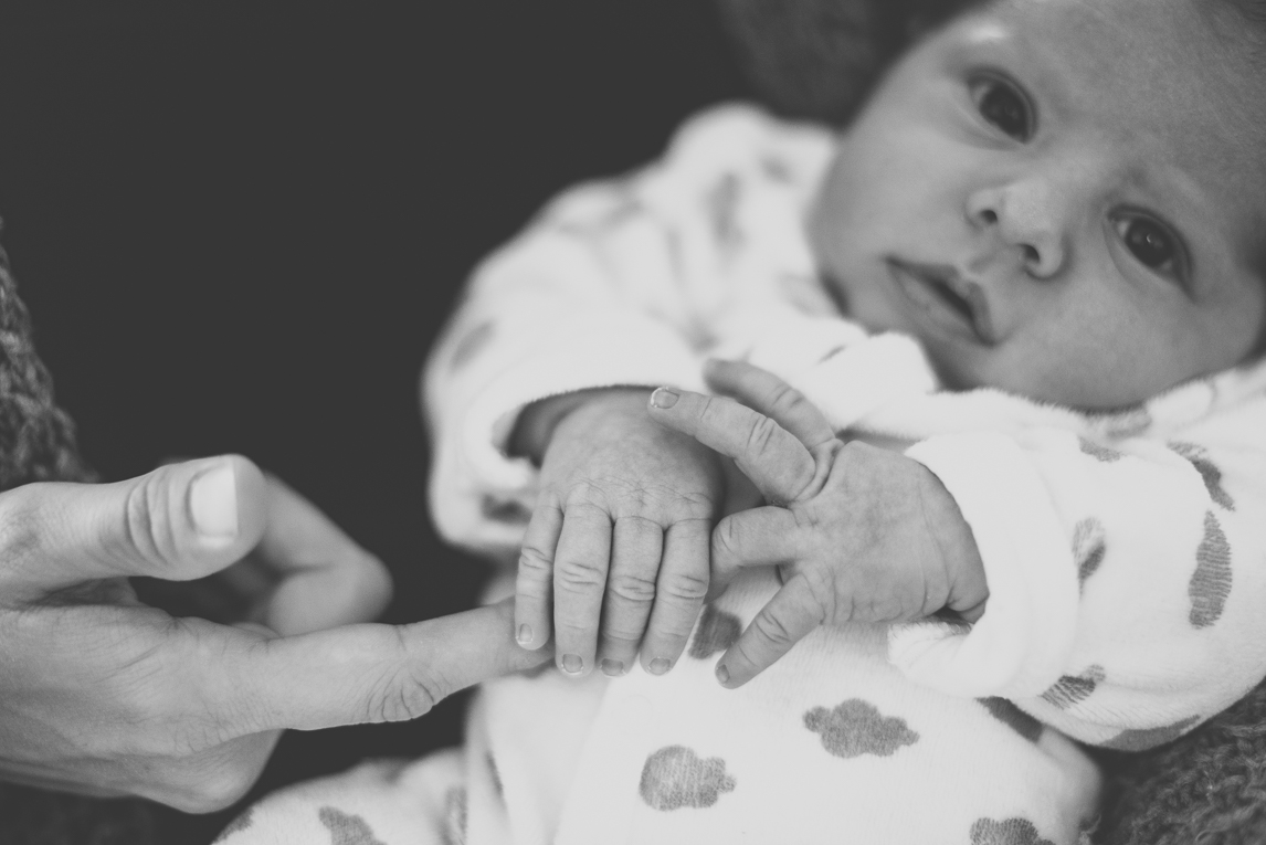 Newborn photo-shoot - baby holds his mum's finger - Newborn Photographer