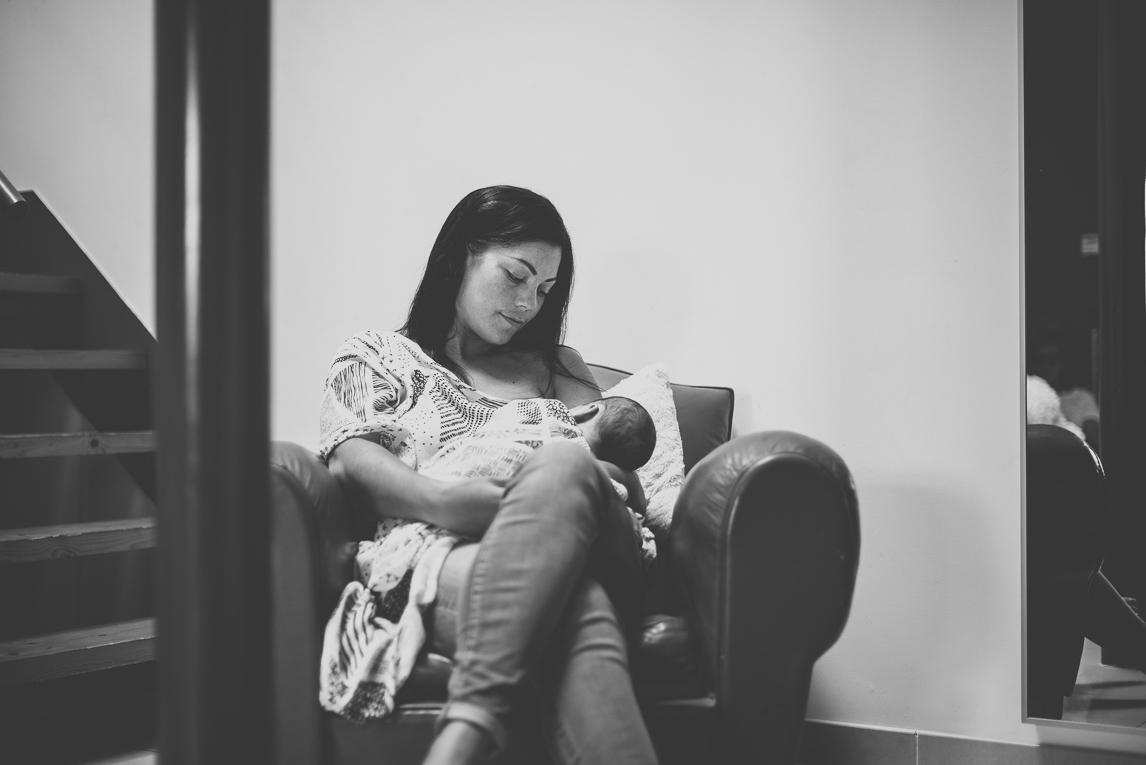 Newborn photo-shoot at home Southern France - mum breastfeeds her newborn - Newborn Photographer
