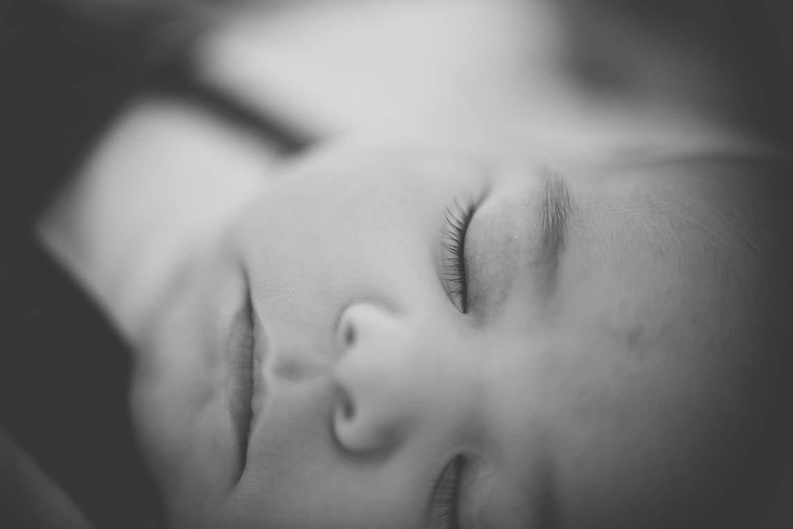 Baby photo session at home - close up on face of sleepy baby - Baby Photographer