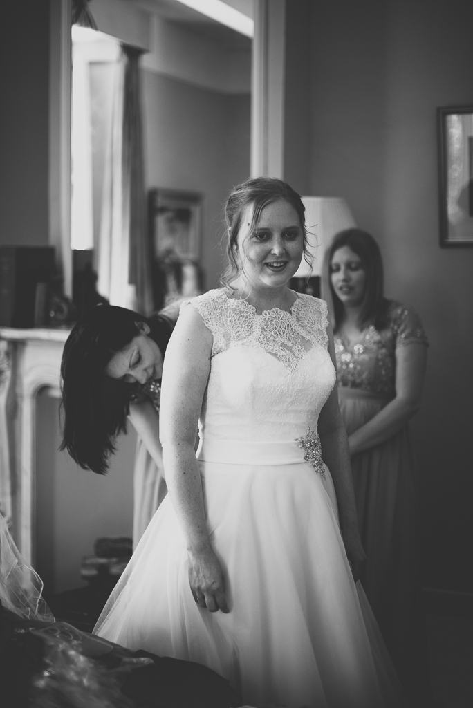 Wedding Photography French château - bride getting dressed - Wedding Photographer
