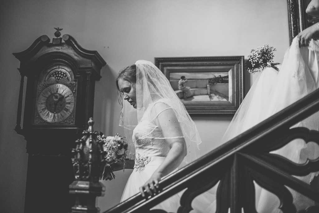 Wedding Photography French château - bride walking down the stairs - Wedding Photographer