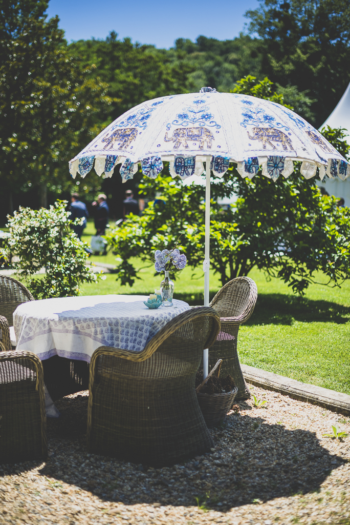 Wedding Photography French château - garden table and chairs and umbrella - Wedding Photographer